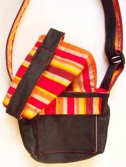 sac à main en cuir noir et tissu en coton à rayures oranges